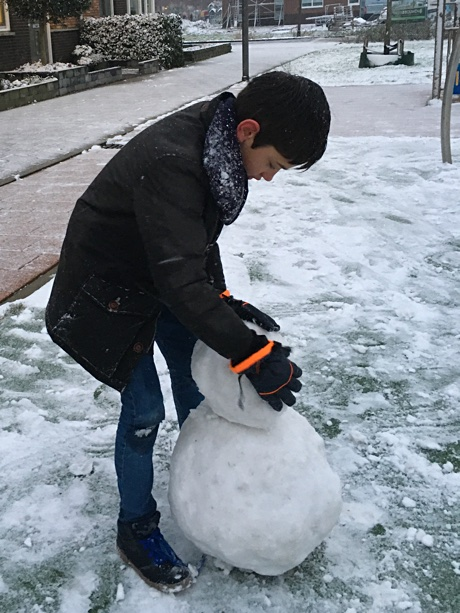 Adam placing the head on the snowman