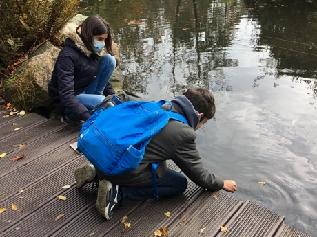 Alice and Adam petting carp