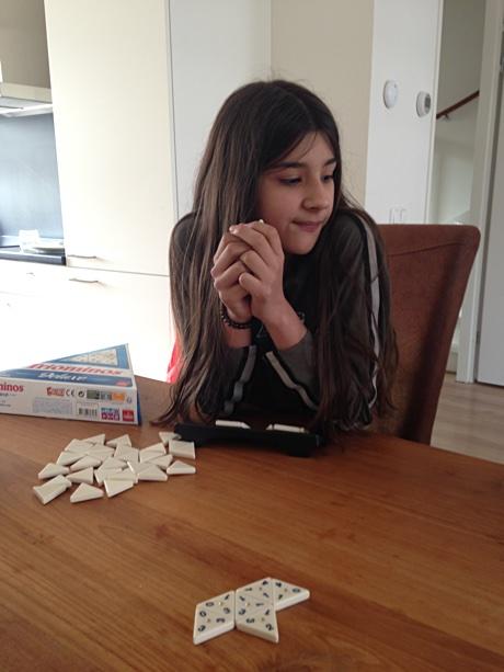 Alice considering her next move in triominos