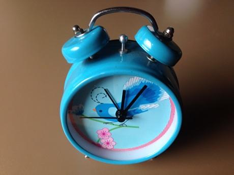 Alarm clock with a blue bird