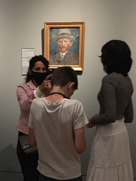 Esme, Adam, and Alice with Vincent van Gogh's self-portrait