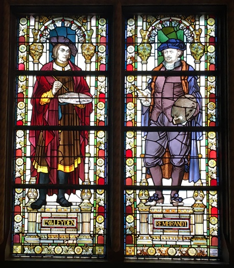 Stained glass windows showing Lucas van Leijden and Rembrandt